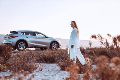 The beautiful sunset, the white suit and the curves of the Infiniti Q30